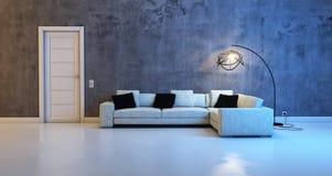 沙发对一个混凝土墙 图库摄影