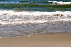 沙子和波浪 库存照片