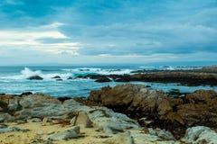 沙子和海浪 免版税库存照片