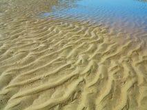 沙子和水 图库摄影