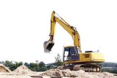 在沙子堆的挖掘机 免版税库存照片