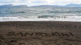 沙子文字-圣托里尼 库存图片