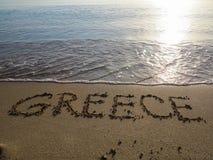 沙子文字-希腊 库存照片