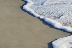 沙子海浪 免版税库存图片