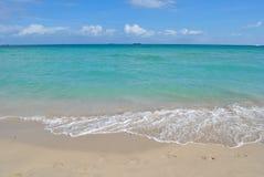沙子海滩水背景 免版税库存照片