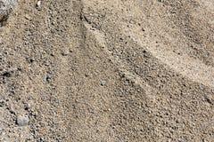 沙子的纹理在太阳的直接光芒的下在湖的 图库摄影