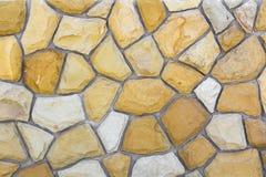 沙子石头的不同的大小 石墙样式背景 图库摄影