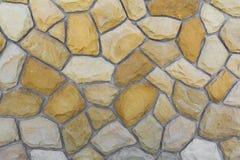沙子石头的不同的大小 石墙样式背景 库存图片