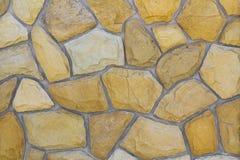 沙子石头的不同的大小 石墙样式背景 免版税图库摄影