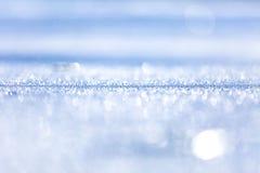 沙子蓝色背景在阳光- 1下 免版税库存图片