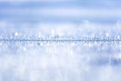 沙子蓝色背景在阳光- 2下 库存图片