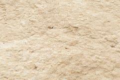 沙子黏土墙壁的纹理 免版税库存照片