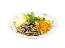 沙拉用肉、红萝卜和油煎方型小面包片 免版税库存图片