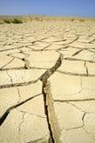 沙漠干燥红色区域海运 库存照片