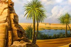 沙漠绿洲和棕榈树 免版税库存图片