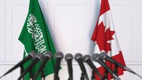 沙特阿拉伯和加拿大的旗子在国际会议或交涉新闻招待会 影视素材