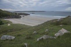 沙滩和多云天空 免版税库存图片