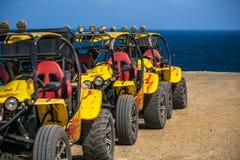 没有司机的黄色海滩儿童车 免版税库存图片