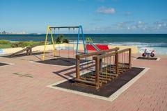 没有孩子的五颜六色的操场地中海海岸的  免版税库存图片