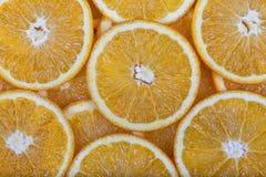 没有小核的桔子切开了成切片 库存图片