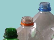 没有快门的三个空的塑料饮料瓶 免版税图库摄影