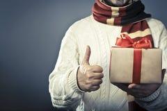 没有拿着礼物盒的面孔男性 图库摄影