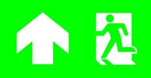 没有文本的紧急/出口标志在标准紧急逃命照明设备的绿色背景 免版税库存图片