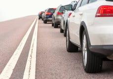 沥青汽车阻塞无缝的业务量向量墙纸 免版税图库摄影