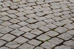 沥青背景路石头适当的阳光纹理 库存图片