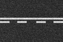 沥青高速公路与标号的路纹理 免版税库存图片