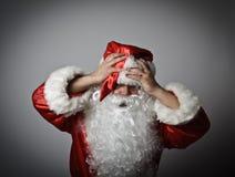 沮丧的圣诞老人 图库摄影