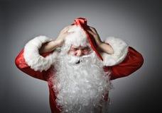 沮丧的圣诞老人 免版税库存照片