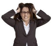 沮丧的女实业家 免版税库存照片