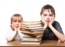 沮丧的孩子有学习困难 免版税库存照片