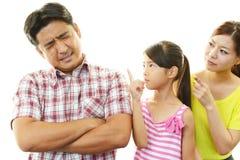 沮丧的家庭 免版税库存照片