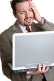 沮丧的膝上型计算机人 库存照片