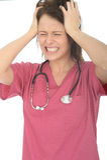 沮丧的被注重的恼怒的美丽的年轻女性医生Pulling Her Hair 图库摄影