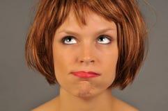 沮丧的认为的妇女 免版税库存照片