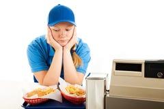 沮丧的青少年的快餐服务器 免版税图库摄影