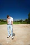 沮丧的高尔夫球运动员 免版税库存图片