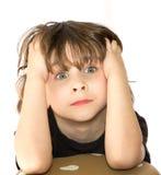 沮丧的年轻男孩 免版税图库摄影