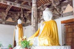 河南,中国- 2015年11月04日:在会善寺(UNES的Budda雕象 免版税库存照片