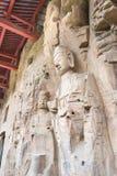 河南,中国- 2015年10月03日:在巩县洞穴的Budda雕象 免版税图库摄影