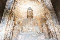 河南,中国- 2015年10月03日:在巩县洞穴的Budda雕象 图库摄影