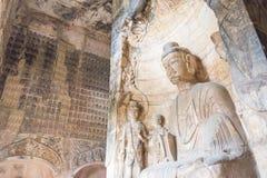 河南,中国- 2015年10月03日:在巩县洞穴的Budda雕象 免版税库存图片
