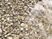 河平稳的石头 库存图片