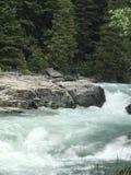 河浪端的白色泡沫 库存照片