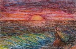 油在白肤金发的妇女帆布的柔和的淡色彩绘画有橙色礼服和橙色帽子的在看天际的海滩在日落期间 免版税库存图片