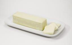 黄油棍子在奶油碟的 库存图片