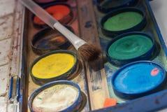 油漆和刷子 免版税图库摄影